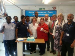 Staff celebrate the first birthday of the OPAU