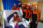 Footballing rivals get in the Christmas spirit at Barnet Hospital