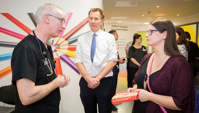 Jonathan Costello, clinical director for the emergency department, talks to Secretary of State for Health Jeremy Hunt and Melissa Mead