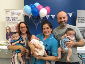 Parents, staff and babies at the Starlight NICU summer party