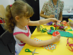 Young girl taking part in craft activity